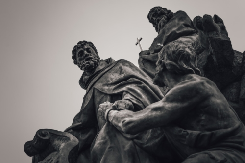 Statue of Saints John of Matha, Feliz of Valois, and Ivan on Charles Bridge. Prague, Czech Republic - slon.pics - free stock photos and illustrations