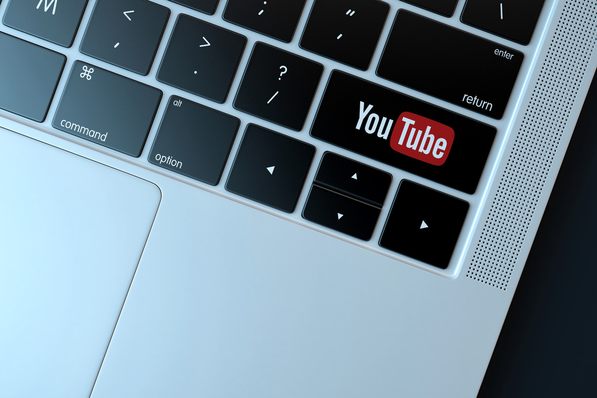 Youtube icon on laptop keyboard. Technology concept - slon.pics - free stock photos and illustrations