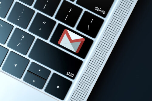 Gmail icon on laptop keyboard. Technology concept - slon.pics - free stock photos and illustrations