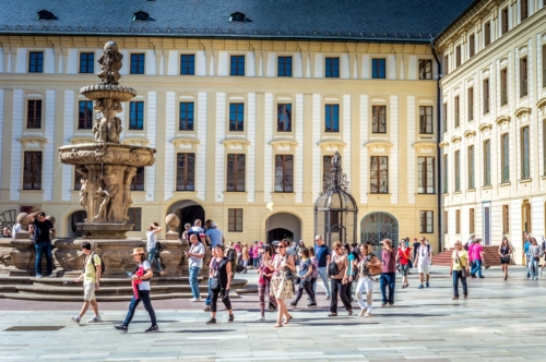 Group of people with a tour guide at the Prague Castle. Prague, Czech Republic. May 18, 2017 - slon.pics - free stock photos and illustrations