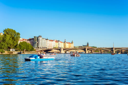Tourists on pedal boat on the Vltava River. Prague, Czech Republic - slon.pics - free stock photos and illustrations