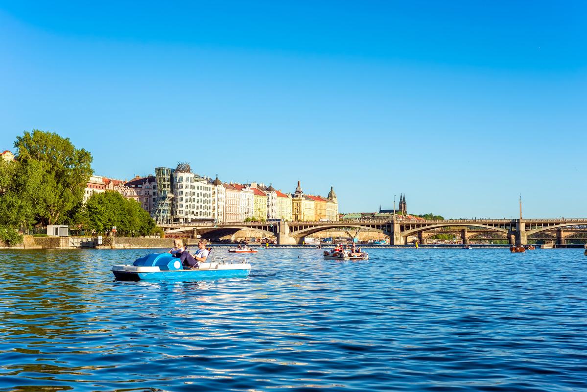Tourists on pedal boat on the Vltava River. Prague, Czech Republic - slon.pics - free stock photos and illustrations