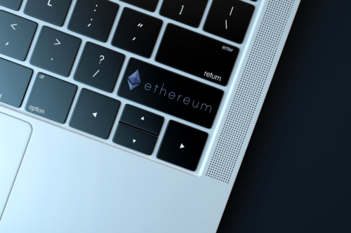 Ethereum icon on laptop keyboard. Technology concept - slon.pics - free stock photos and illustrations