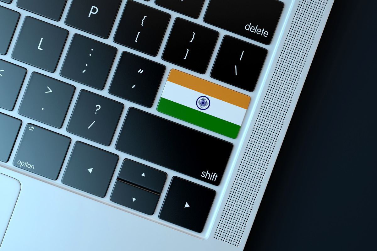 Flag of India over computer keyboard. Technology concept - slon.pics - free stock photos and illustrations