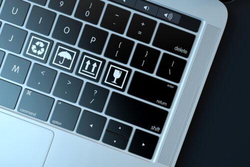 Fragile symbols on laptop keyboard. Technology concept - slon.pics - free stock photos and illustrations