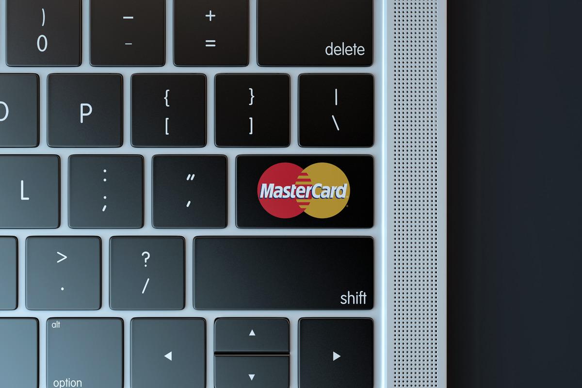 Mastercard logo on laptop keyboard - slon.pics - free stock photos and illustrations