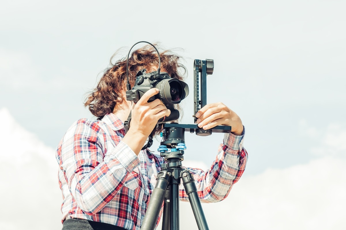 Photographer Setting Up Her Camera - slon.pics - free stock photos and illustrations