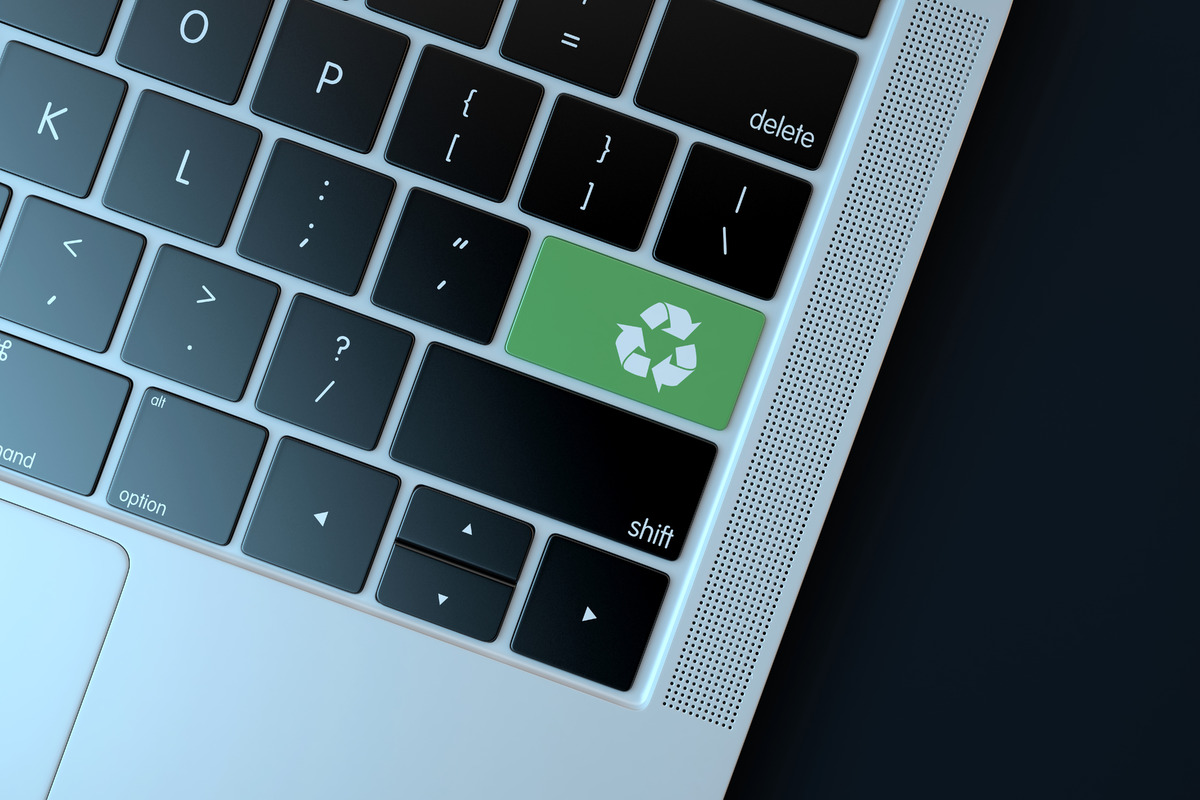 Recycle icon on laptop keyboard. Technology concept - slon.pics - free stock photos and illustrations