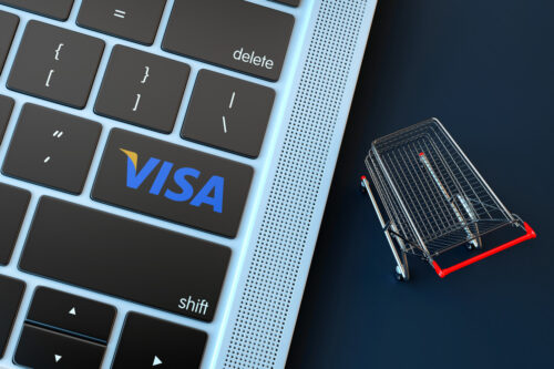VISA logo on laptop keyboard and miniature shopping cart - slon.pics - free stock photos and illustrations