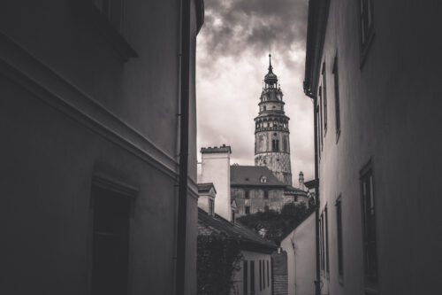 View of a cstle tower through the narrow street of Cesky Krumlov - slon.pics - free stock photos and illustrations