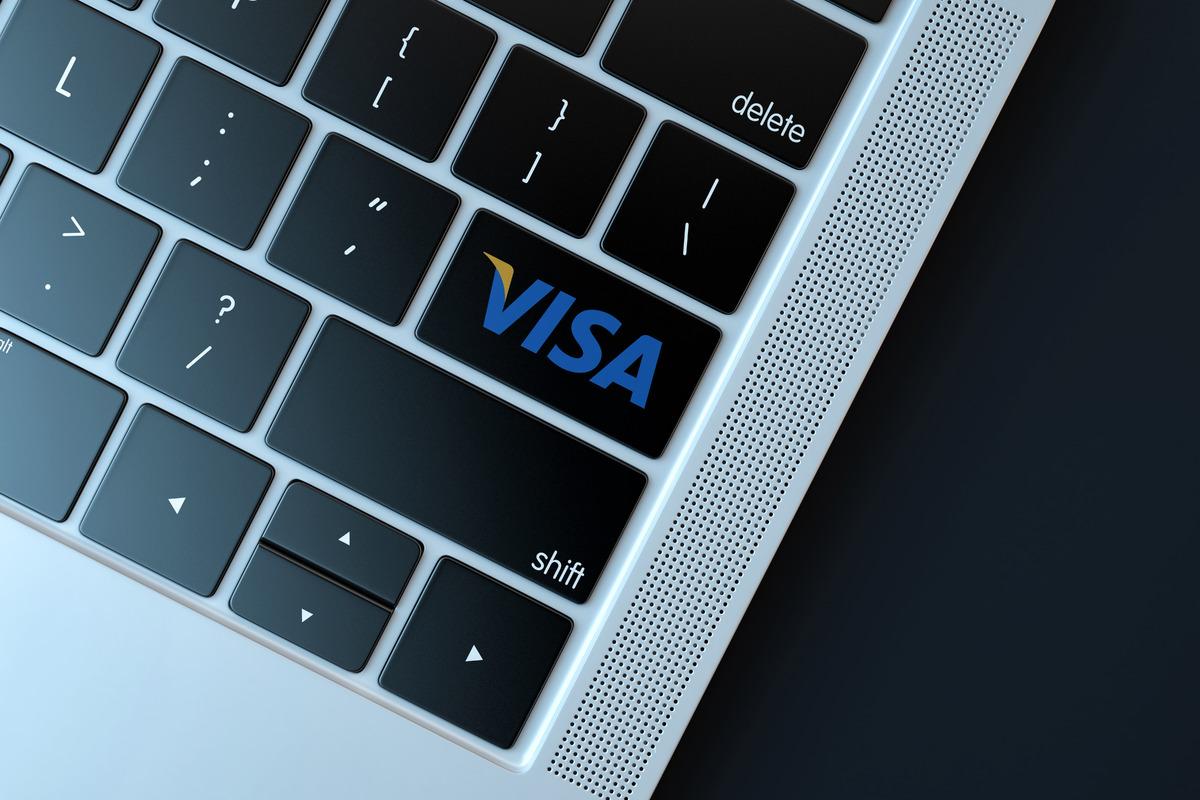 Visa logo on laptop keyboard - slon.pics - free stock photos and illustrations