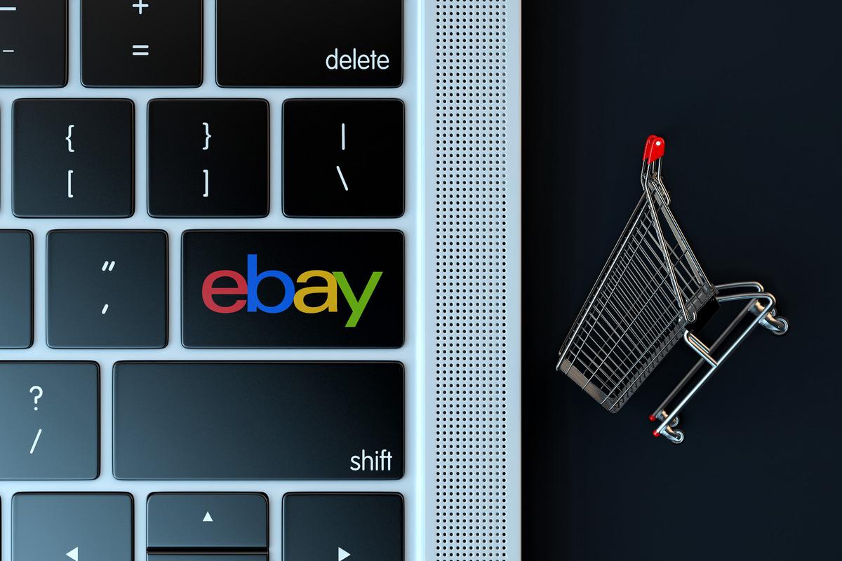 EBAY logo on laptop keyboard and miniature shopping cart - slon.pics - free stock photos and illustrations