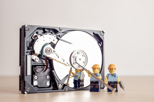 Technicians fixing HDD drive - slon.pics - free stock photos and illustrations