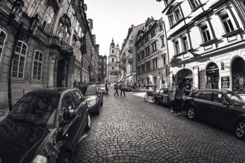 View of Mostecka street with St Nicholas church in the background. Mala Strana, Prague, Czech Republic. May 18, 2017 - slon.pics - free stock photos and illustrations