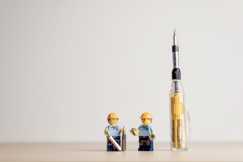Construction workers with screwdriver - slon.pics - free stock photos and illustrations
