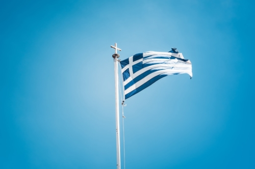 Greek flag waving against blue sky - slon.pics - free stock photos and illustrations