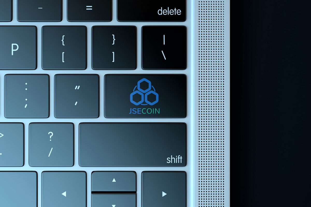 JSECoin logo on laptop keyboard - slon.pics - free stock photos and illustrations