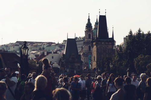 People walking across Charles Bridge. Prague, Czech Republic - slon.pics - free stock photos and illustrations