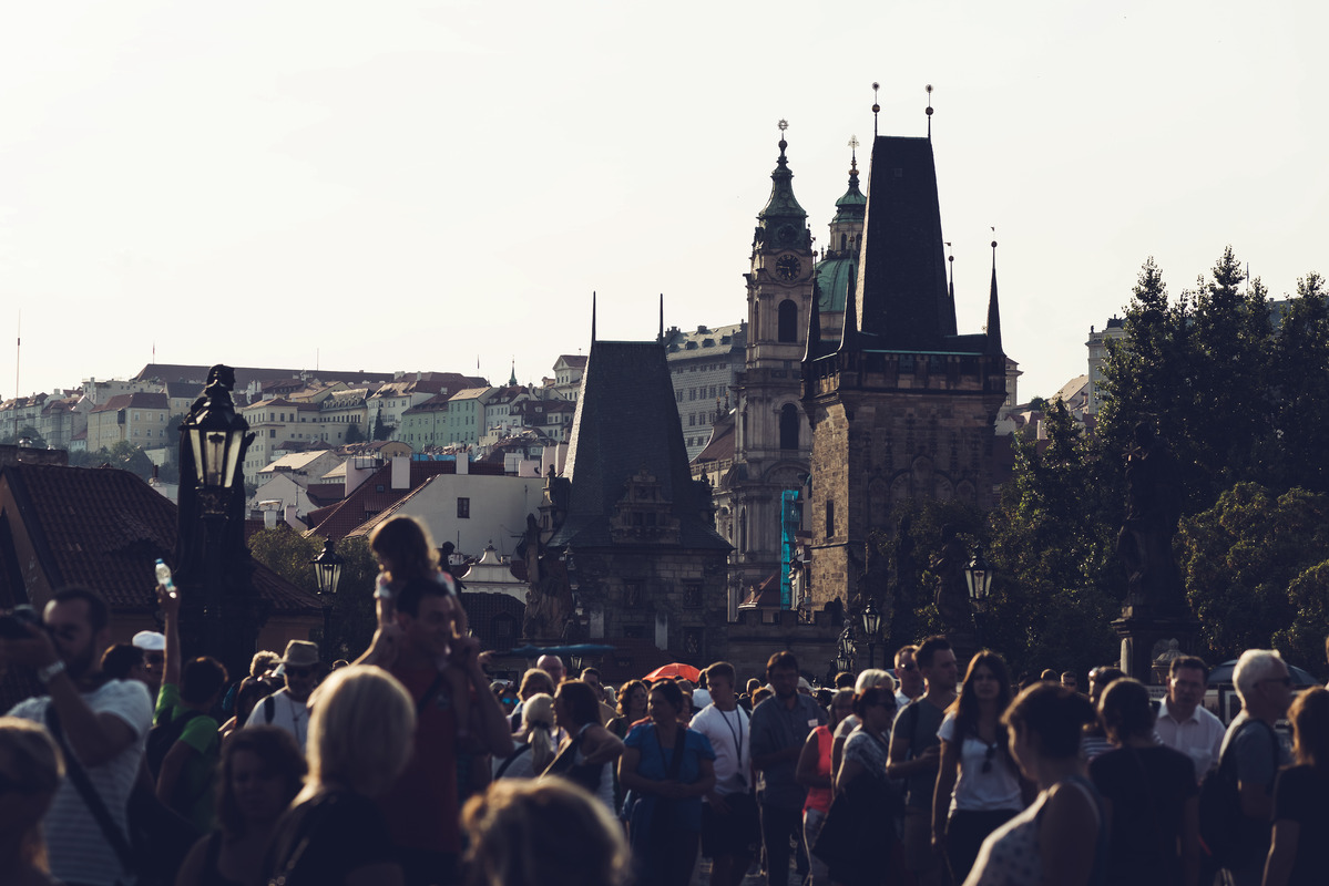 People walking across Charles Bridge. Prague, Czech Republic - slon.pics - free stock photos and illustrations