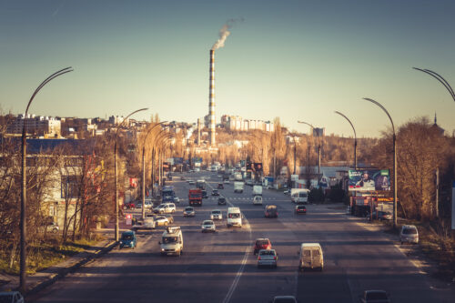 Smoking factory chimneys at the end of Albisoara street. Moldova, Chisinau - slon.pics - free stock photos and illustrations