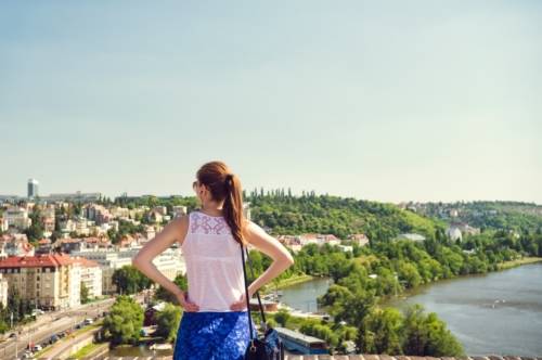 Woman enjoying panoramic view of Prague. Czech Republic - slon.pics - free stock photos and illustrations