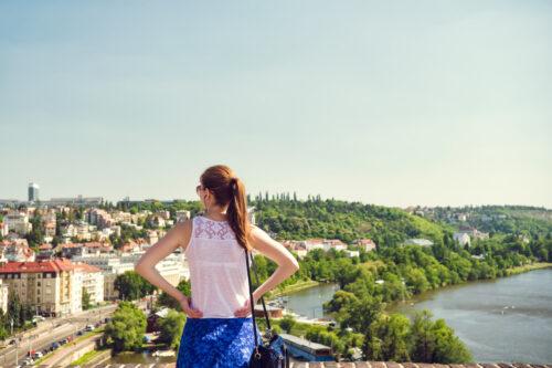 Woman enjoying panoramic view of Prague. Czech Republic - slon.pics - free stock photos and illustrations