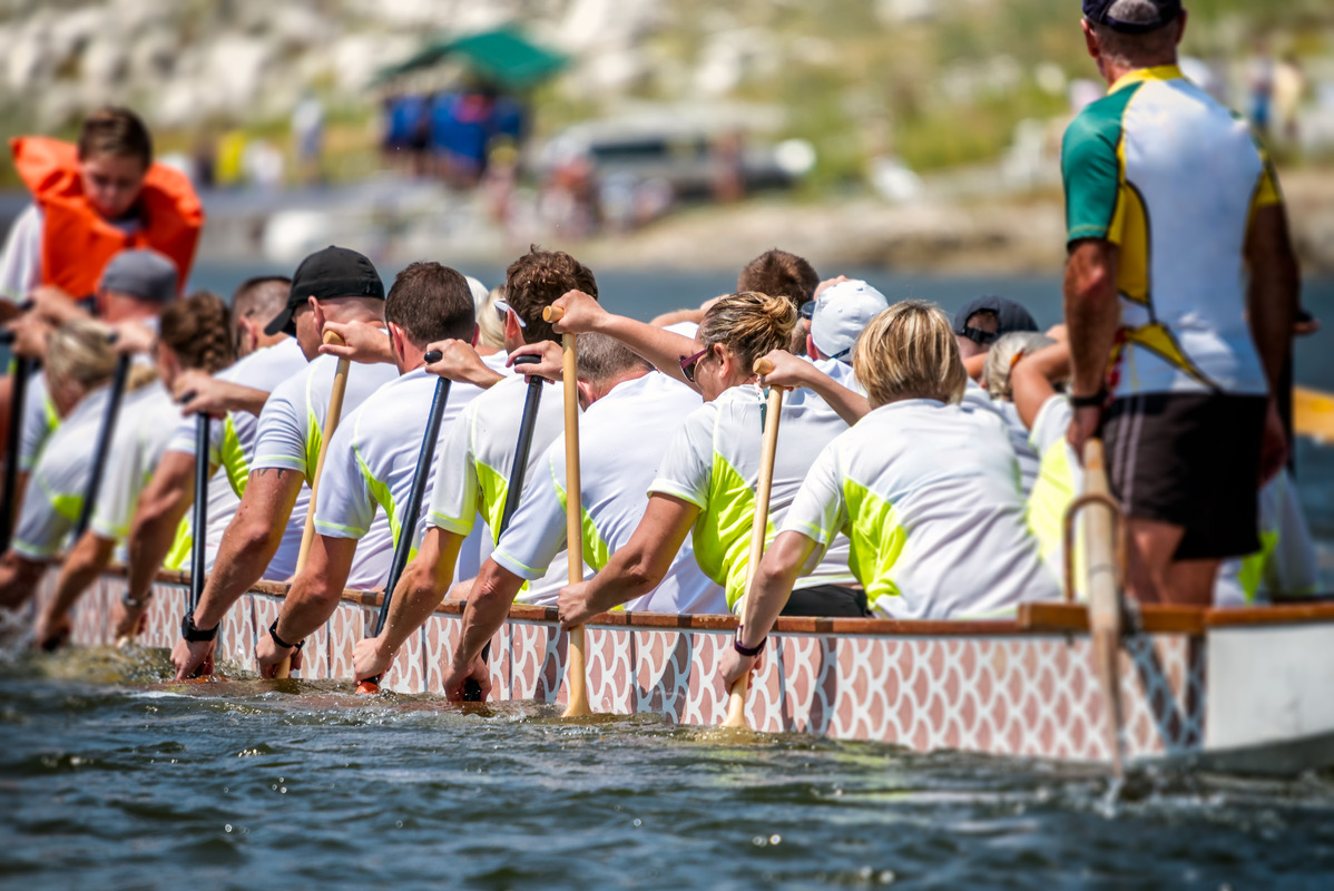 A team of dragon boat racers paddling their boat - slon.pics - free stock photos and illustrations