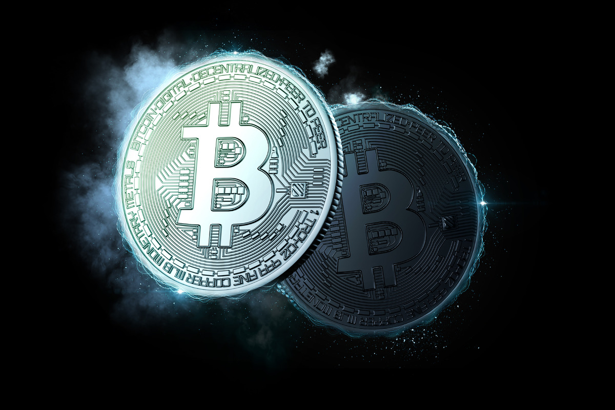 Bitcoin coins glowing in the dark - slon.pics - free stock photos and illustrations