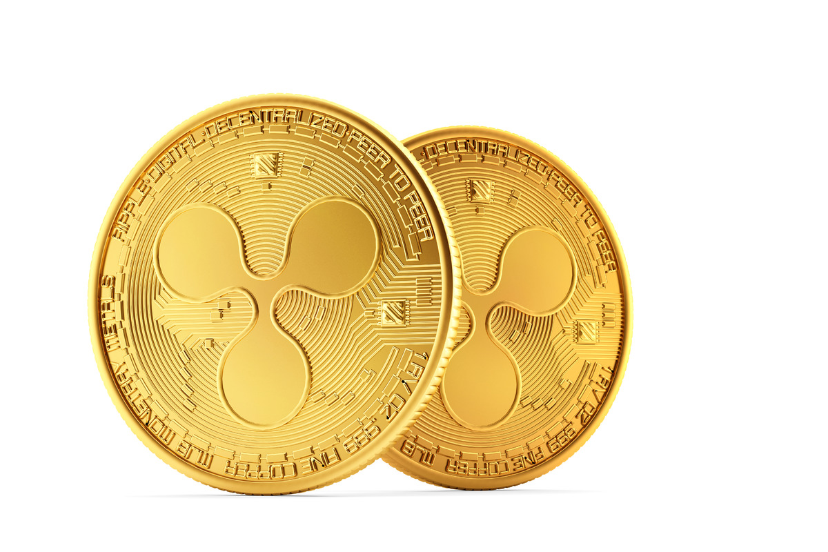 Golden Ripple coins on white background - slon.pics - free stock photos and illustrations