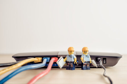 Technicians connecting network cable - slon.pics - free stock photos and illustrations