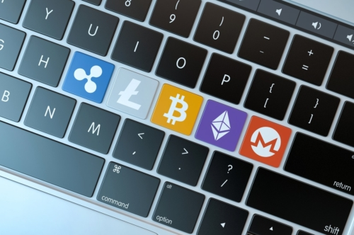 Various cryptocurrencies symbols on laptop keyboard. Technology concept - slon.pics - free stock photos and illustrations