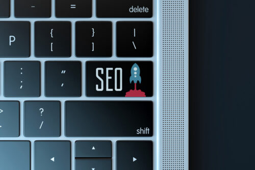 Search engine optimization sign over laptop keyboard - slon.pics - free stock photos and illustrations