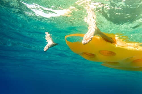 Yellow mattress flowing on the water - slon.pics - free stock photos and illustrations