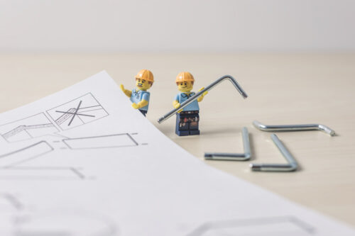Carpenters with furniture assembly instructions - slon.pics - free stock photos and illustrations