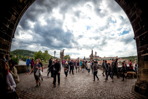 Crowd of people on Charles Bridge, a UNESCO World Heritage Site - slon.pics - free stock photos and illustrations