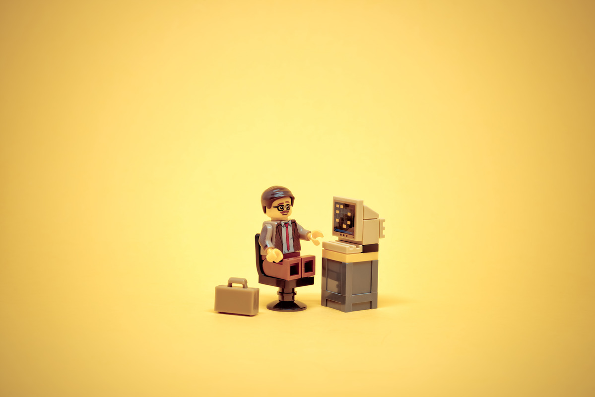 Office clerk with old style PC - slon.pics - free stock photos and illustrations