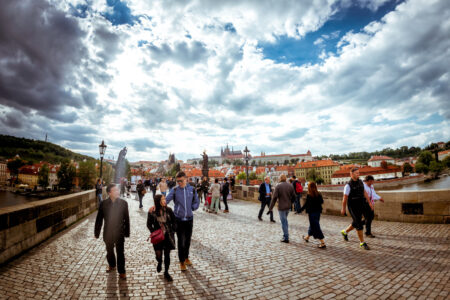People walking across the historical Charles Bridge - slon.pics - free stock photos and illustrations