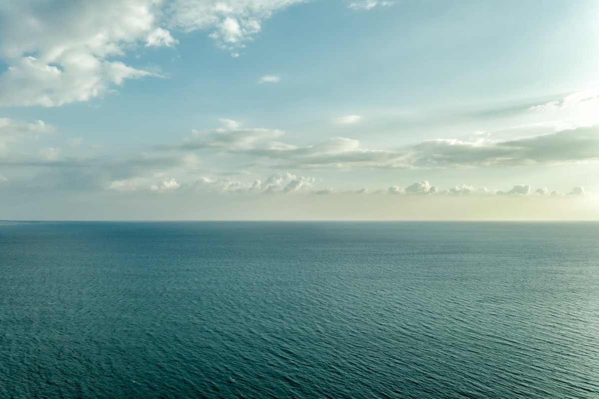 Sea water surface lit by sunset light - slon.pics - free stock photos and illustrations