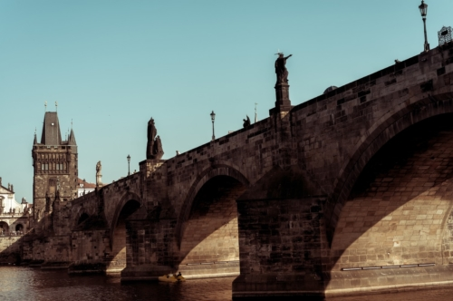 The historic 14th century Charles Bridge in Prague over the river Vlatava - slon.pics - free stock photos and illustrations