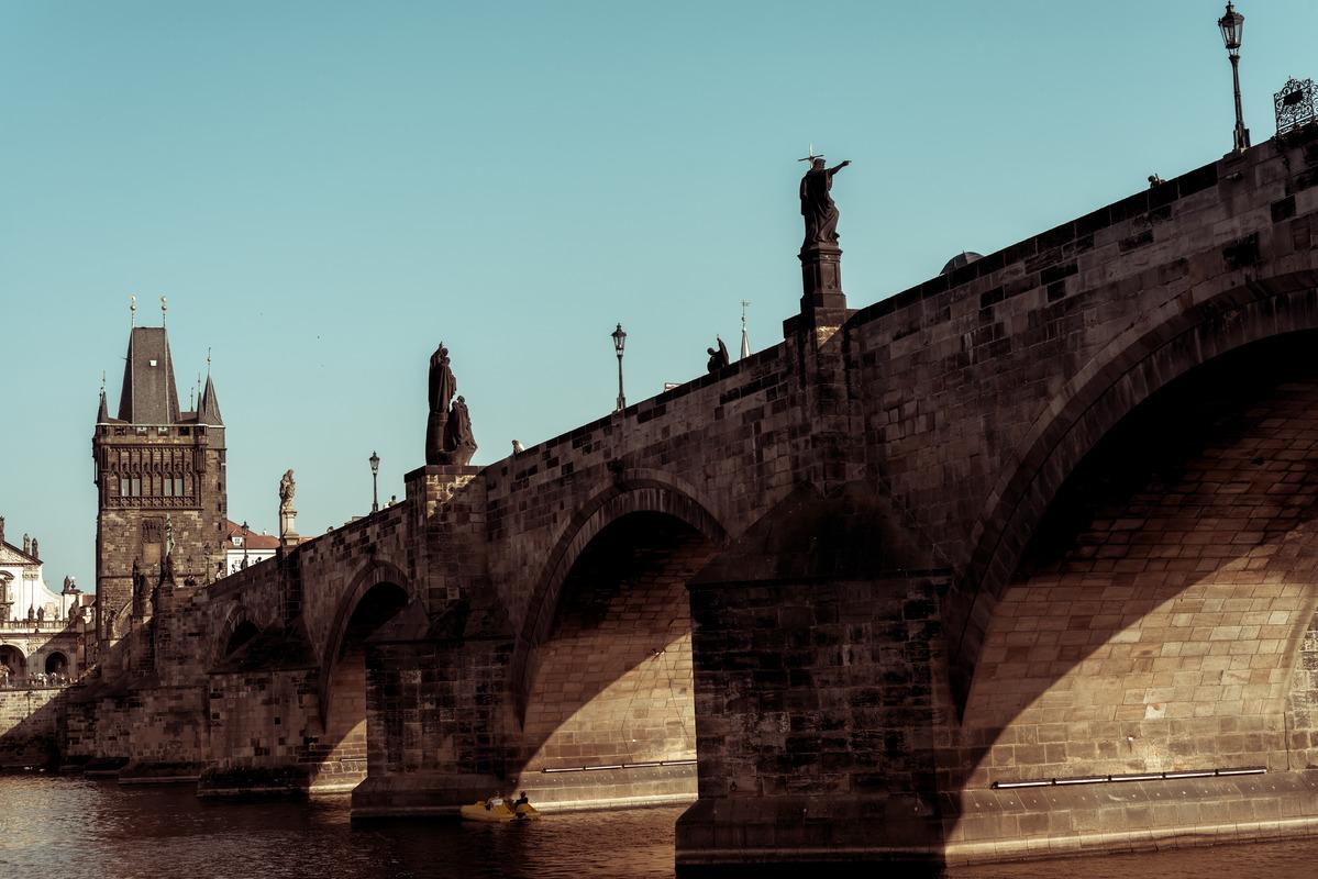 The historic 14th century Charles Bridge in Prague over the river Vlatava - slon.pics - free stock photos and illustrations