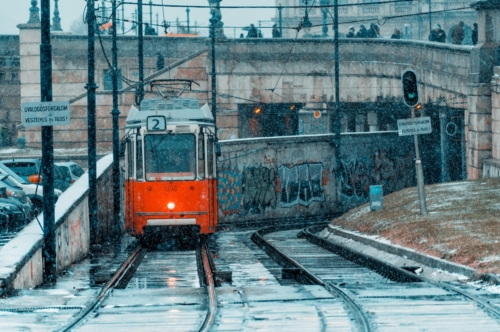 Tram on city railroad on a cold winter's day - slon.pics - free stock photos and illustrations