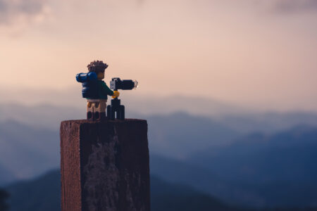 Nature photographer taking photos at sunset in the mountains - slon.pics - free stock photos and illustrations