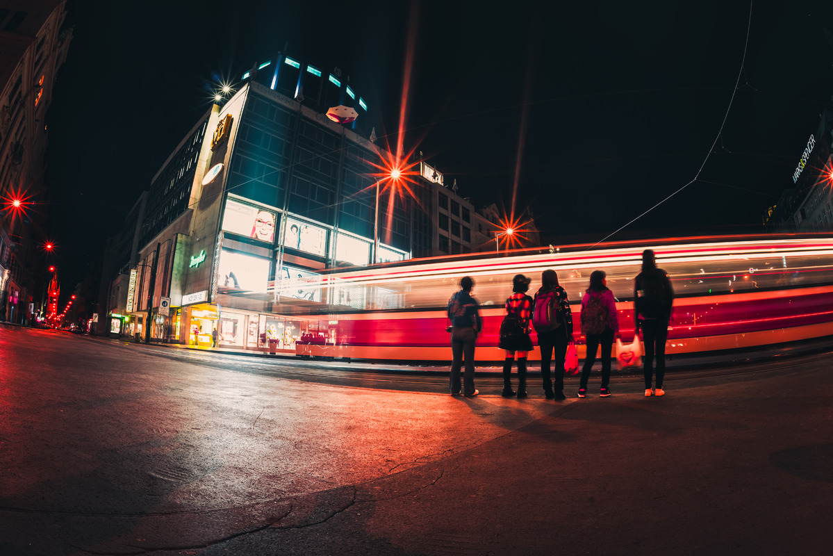 People on street amidst light trails at night - slon.pics - free stock photos and illustrations