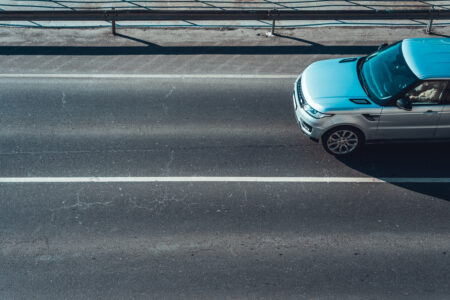 Car moving on empty road lane - slon.pics - free stock photos and illustrations