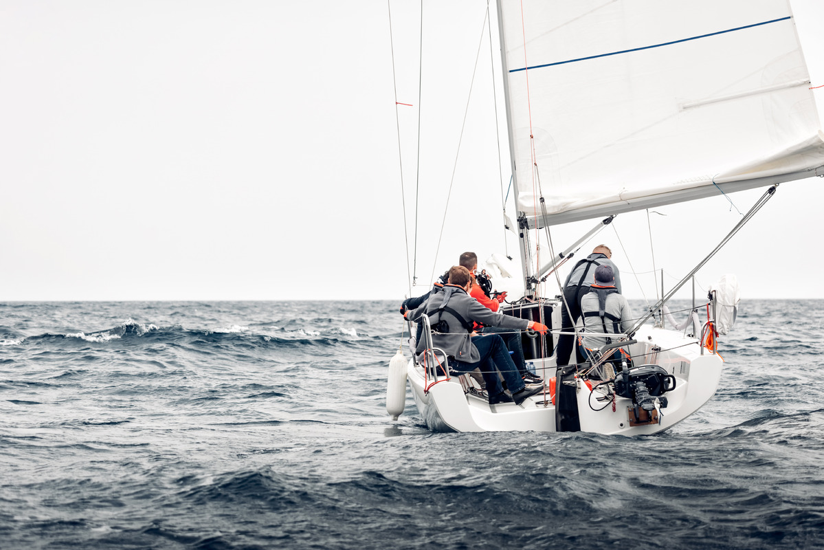 Sailing boat breaking through a stormy sea - slon.pics - free stock photos and illustrations