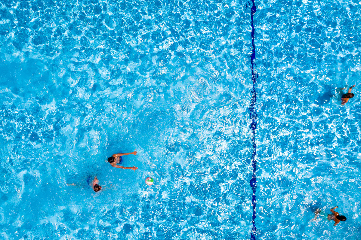 Swimming pool with playing people, overhead view - slon.pics - free stock photos and illustrations