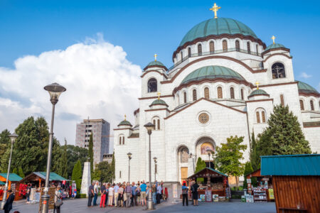 Tourists standing in front of the Saint Sava cathedral in Belgrade. Serbia - slon.pics - free stock photos and illustrations