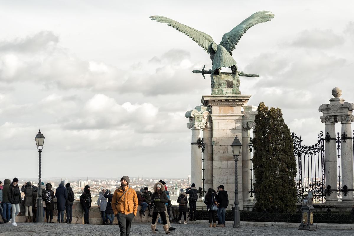 Tourists walk at Buda Castle near the Turul bird. Budapest - slon.pics - free stock photos and illustrations