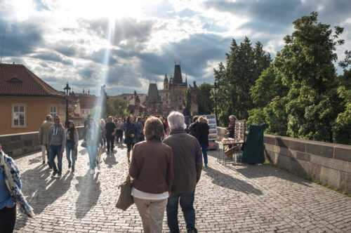 Tourists walking across The Charles Bridge. Prague - slon.pics - free stock photos and illustrations