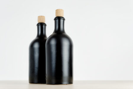 Two empty bottles on a table - slon.pics - free stock photos and illustrations